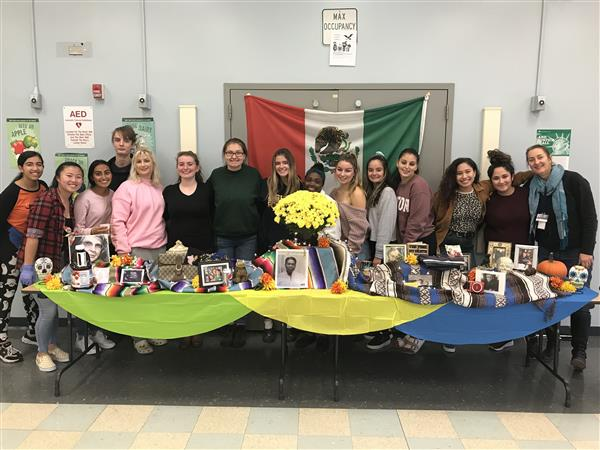 Students with their Day of the Dead Display