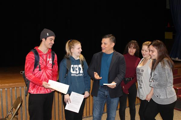 Following John Penzella's presentation, Highland High School students speak with the author.