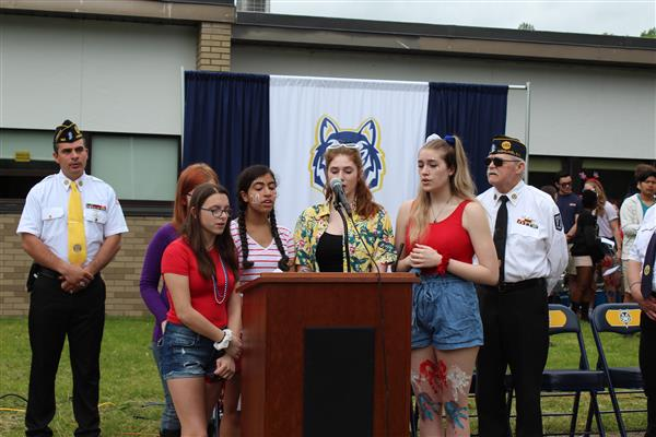 Students singing at Memorial Day assembly.